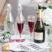 Santa Margherita Prosecco for a Champagne Pomegranite Cocktials for the Holidays by Fashionable Hostess
