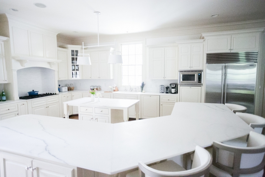 Amazing White Marble Countertops And Urban Electric Light Fixture With Cabinets On Fashionable Hostess
