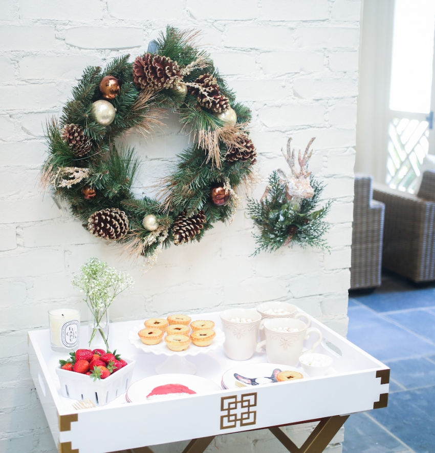 Holiday with Pier 1 featuring Pier 1 Mugs, Puppy Plates, Wreath, Deer Head Decor, and Cake Plate on Fashionable Hostess